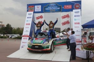 KOCAELI, TURKEY - AUGUST 23, 2015: Murat Bostanci with Ford Fiesta S2000 of Castrol Ford Team Turkiye in Podium Ceremony of Kocaeli Rally 2015